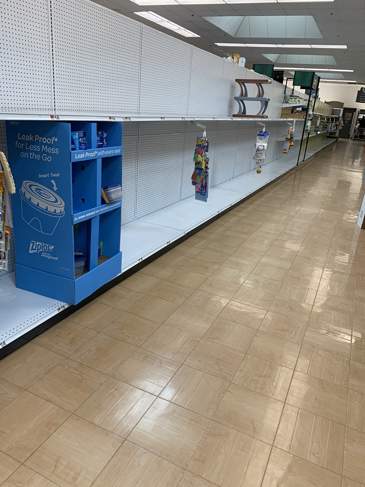 A grocery store isle with empty shelves