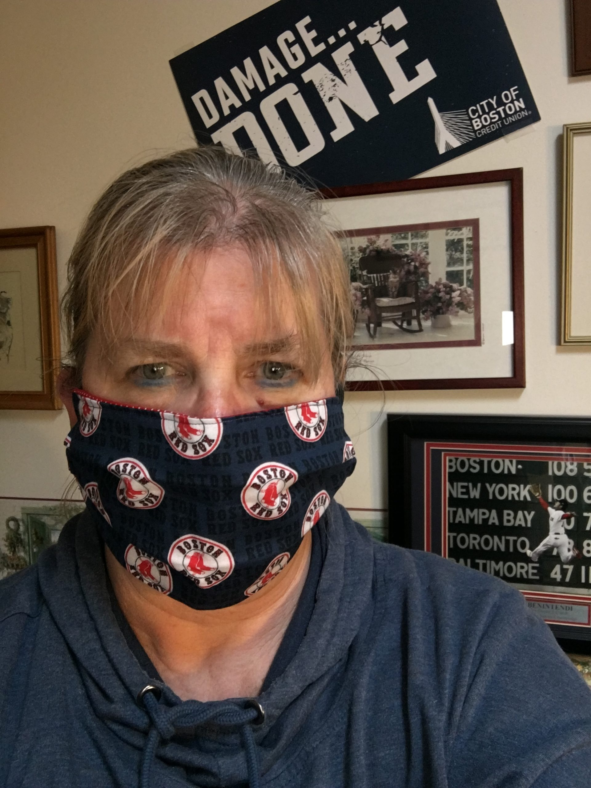Woman with Red Sox face mask.