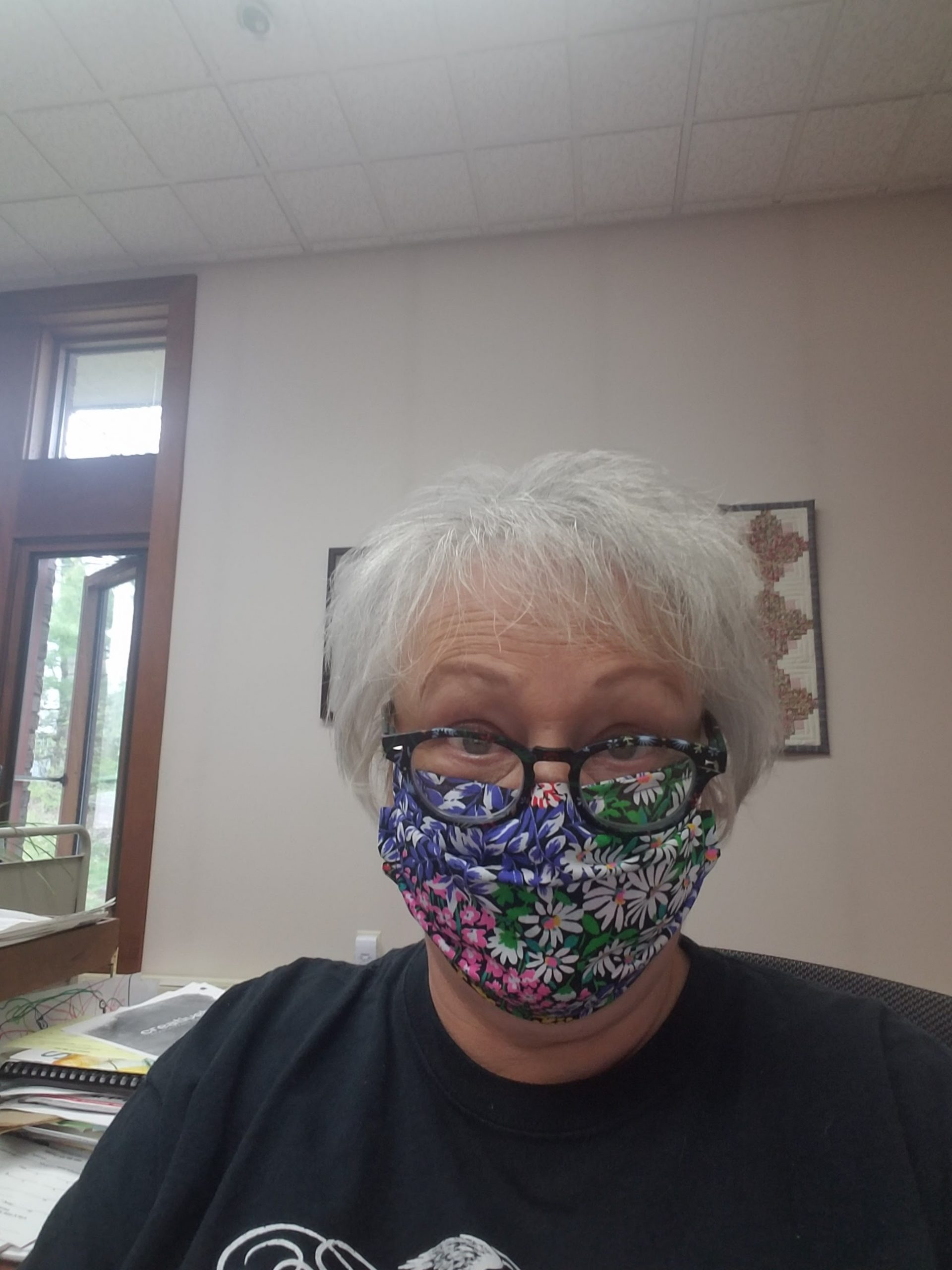 Woman wearing floral patterned face mask