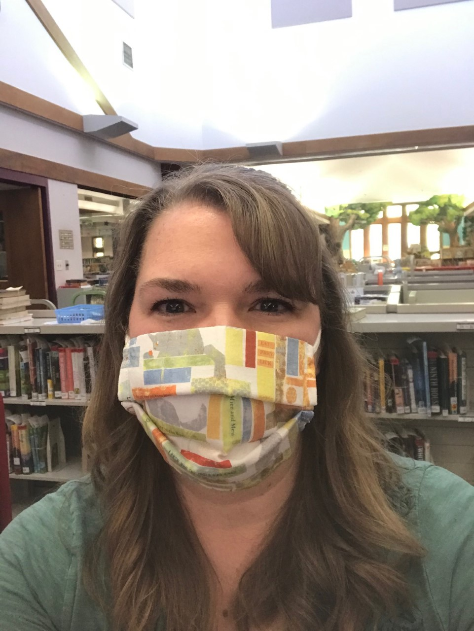 Woman wearing book print face mask